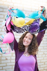 Dana holding colorful bras. Donate your bras