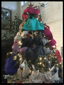 Christmas tree with lights and bras hanging